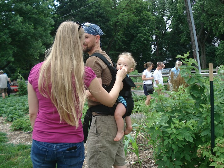 Joel and Laura feed a fresh-picked POP berry to their baby. Fresh fruit pleases people of all ages!